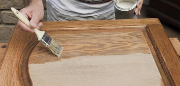 كيفية دهان الخشب موضوع