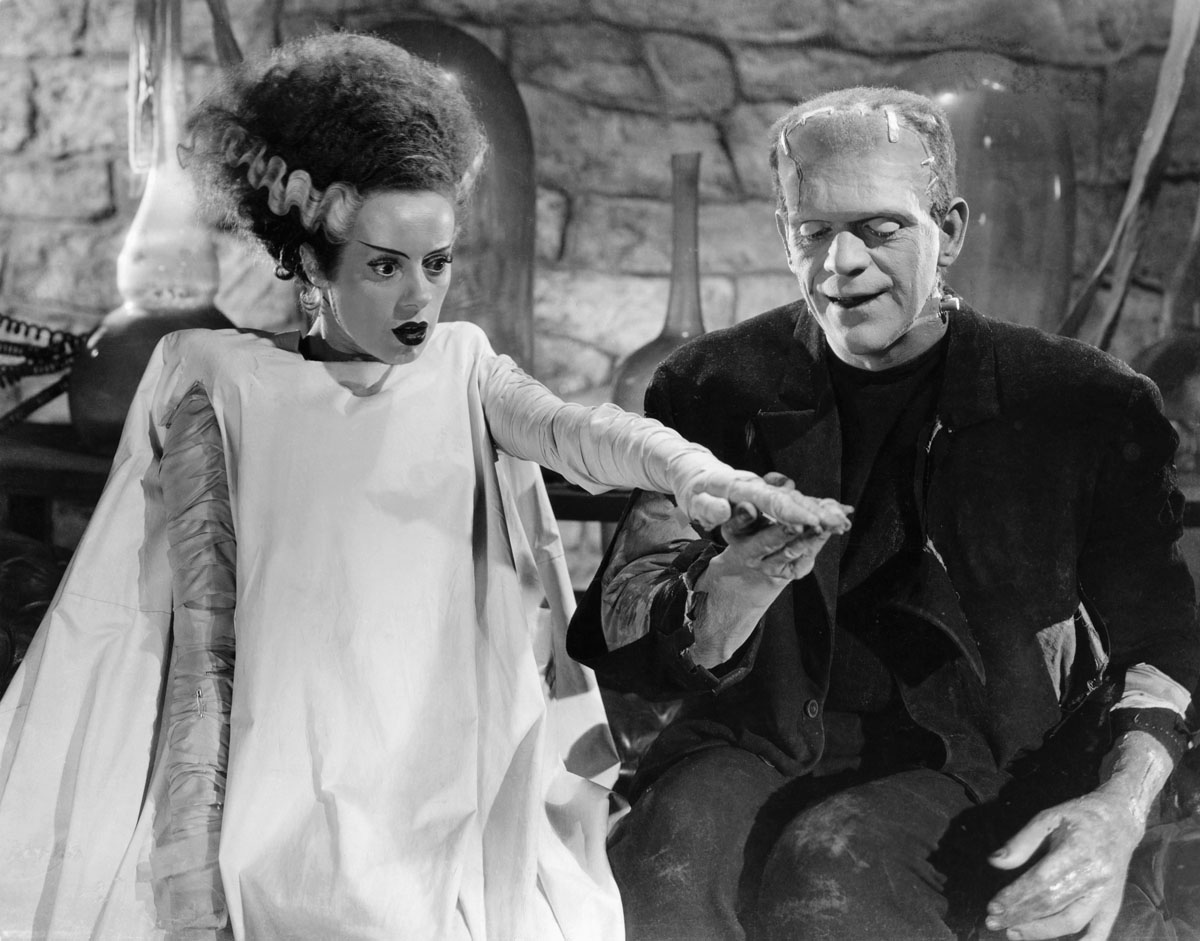 "Original Caption: The Happy Couple: Boris Karloff and Elsa Lanchester hold hands after being introduced. Still from the ""Bride of Frankenstein."" BPA2# 5426"