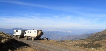 Two overland trucks parked on the edge of the hill in Cocuy