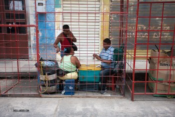 Some street traders ran out of stuff to sell, so just played cards.