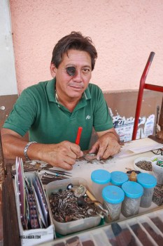 This guy was fixing old watches, replacing batteries etc.