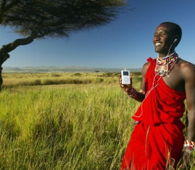 144077655 Masai warrior listening to music on iPod by Apple. Photo: Visions of America/UIG/ Getty