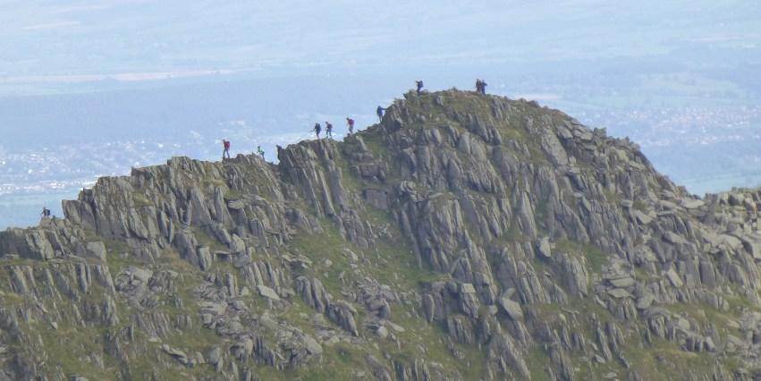 14 stick men on Striding Edge