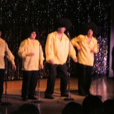 """The Rotary's own all male version of Gladys Knight and the Pips sing the hit song """"Midnight Train to Georgia."""""""