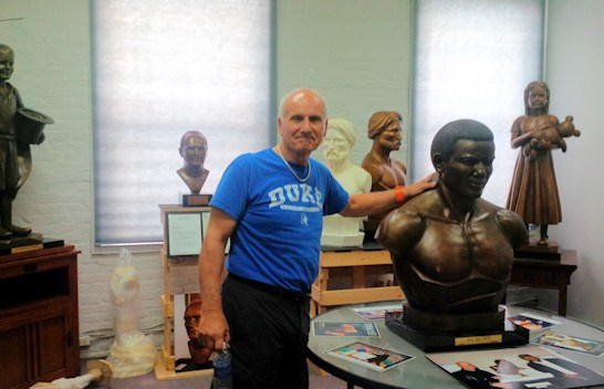 Morelli with a casting of a bust of athlete Jim Brown made for the Syracuse Football Hall of Fame
