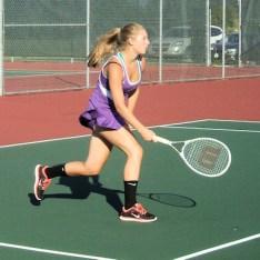 Caitlin Gannon returns a shot