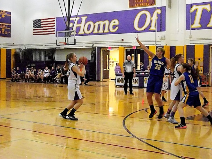 Caitlin Gannon attempting a three point shot