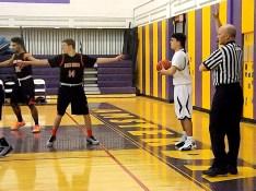 Brian Stanavich guarded by #14 Zach Pierce