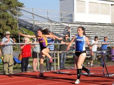 McKenna Palczak (left) in hurdles
