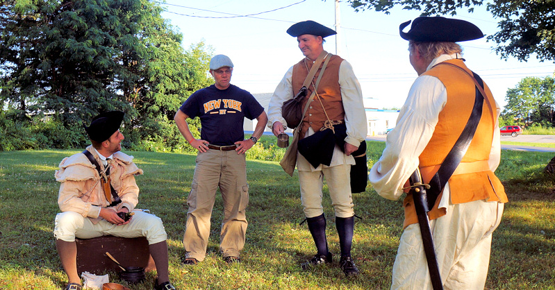 """Writer and Director Kyle Jenks (second from left) stages a scene from """"Drums Along the Mohawk"""""""