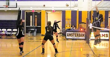 A hit by Maria Lomanto goes over the net