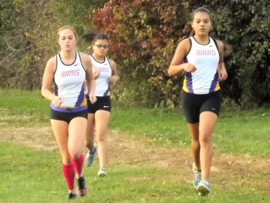 AHS runners Kayla Dzikowicz (l) Dahlia Quinones (r), and Gabby Feliciano (behind)