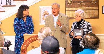 Gene and Nancy accept on behalf of their son Dr. Tom Catena