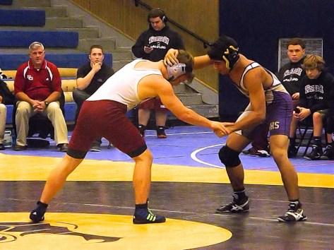 Javier Estrada wrestles Jake Hershberger
