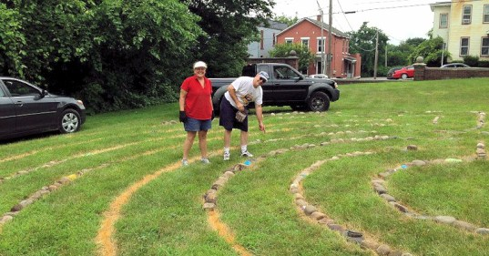 Volunteers construct labyrinth in 2013. Photo used courtesy of Ann Thane.