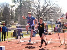 Michael Johnson (left) in the hurdles