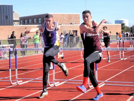 Marcos Santiago (left) and Taylor McCredie in the hurdles
