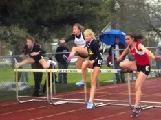 Kayla Dzikowicz (second from left) in the hurdles