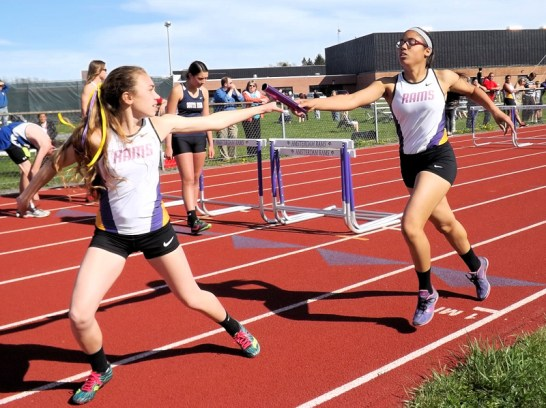 Emma Gomez and Olivia Lazarou in the 4x800 relay