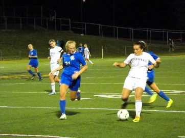 Rena Peconie (#7) tries to get past Ali Visco