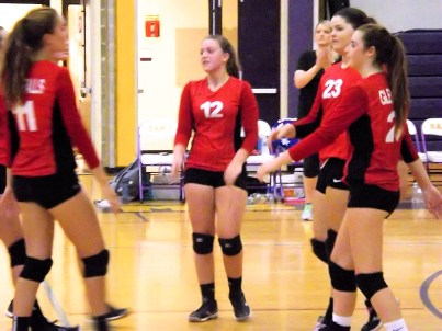 Ella Kules celebrates a point with her team