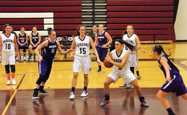 Gloversville's Kerri Hauser collects a rebound