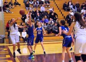 Grace Catena passing the ball around a Queensbury defender