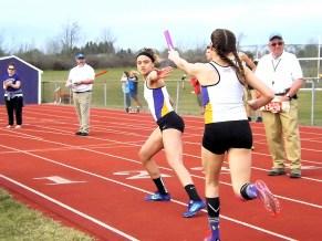 Kayla Sondrup hands off to Edena Sanchez in the 4x8 relay