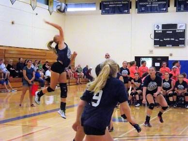 Olivia Casey makes a back court kill
