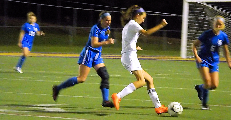 Antonia May puts a kick on goal