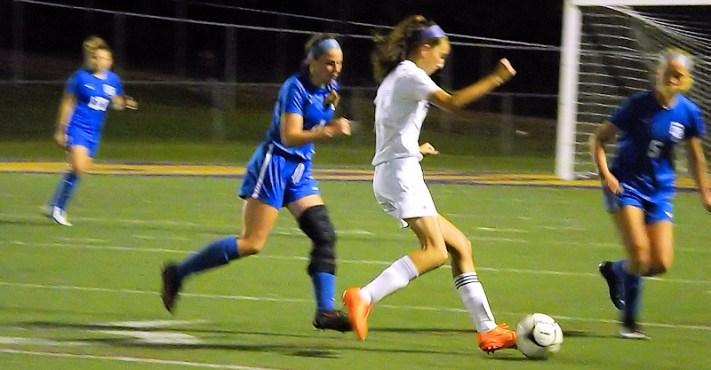 Antonia May puts a kick on goal