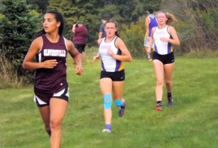 Rhea Winter of Gloversville with Amsterdam's Kayla Sondrup and Brook Marshall