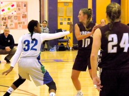 Amani Free (#32) guards Harmony Philo (#10)