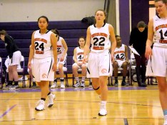 Karen Huang (#24), Maggie Kirby (#22), and Julianna Okoniewski (#14)