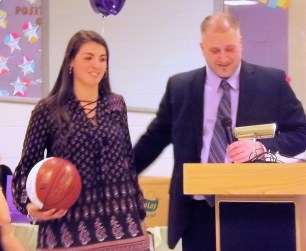 Giuliana Pritchard receiving trophy case ball from Coach Duemler
