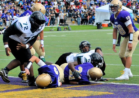 AHS quarterback Trey Ausfeld (21) gets into the end zone for the Rugged Rams' first touchdown