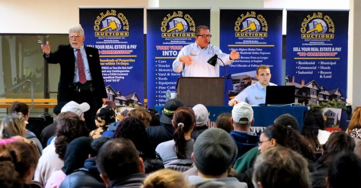 Collar City Auctions conducts an auction of city-owned foreclosed properties at Riverfront Center in Amsterdam