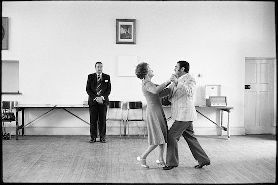 David Goldblatt, Dancing-master, Ted van Rensburg, watches two of his ballroom pupils, swinging to a recording of Victor Sylvester and his Orchestra, in the MOTHS' Hall at the old Court House., 1980. Courtesy of the artist and Goodman Gallery.