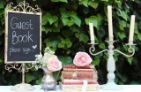 One of our favourite looks for a Guest Book table! MD063 shabby chic chalkboard, MD081 bookstacks and MD044 candelabra