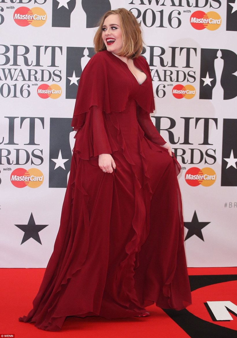 3185A5C100000578-3462343-A_vision_Adele_27_shunned_her_usual_all_black_look_for_a_vivid_r-m-330_1456340084452