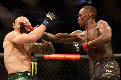 Adesanya throws a right on Marvin Vettori during their championship match. PHOTO: AFP