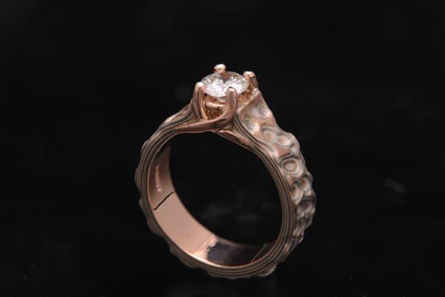 carved red gold diamond ring