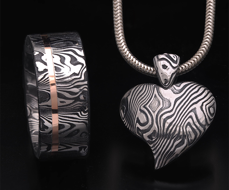 Matching damascus ring and heart pendant