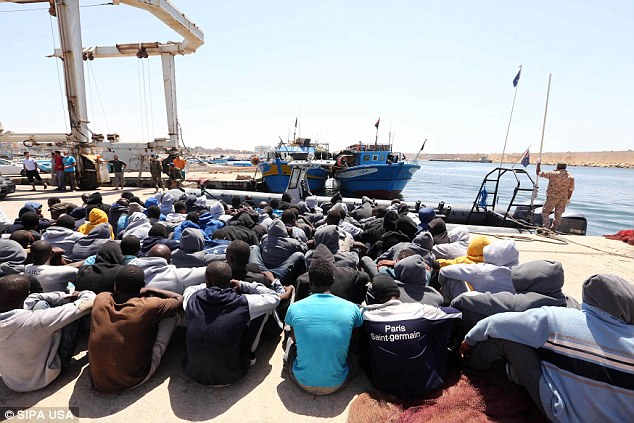 Mr de Kerchove also cautioned there is an increasing risk Libya will be used as a 'springboard' to launch attacks on Europe. Pictured, migrants rescued off the coast of Libya in June