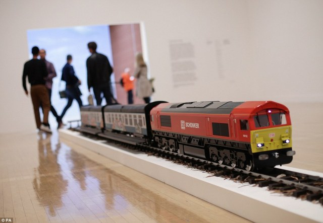 A model of a train entitled The New Media Express in a Temporary Siding (Baby Wants To Ride) 2016 has been installed by artist Josephine Pryde