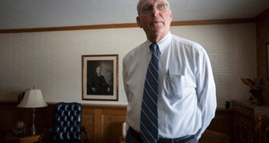 Attorney A.M. Spradling, of Cape Girardeau, Mo., in his office Tuesday morning.  He is challenging the fees attorneys from St. Louis charge in cases he is involved in.  A signed photo of President Harry Truman hangs in his father's office.   Photo By: KAREN ELSHOUT