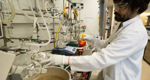 Darryl Kato, research scientist for Gilead Sciences Inc., works on the synthesis of a potential hepatitis C virus drug candidate at the company's lab in Foster City, California, U.S., on Wednesday, Feb. 8, 2012. Gilead acquired Pharmasset Inc. last month for its experimental hepatitis C treatments as it aims to compete with other drugmakers like Bristol-Myers Squibb Co. and Merck & Co. to develop a new class of oral cures for hepatitis C to replace older drugs that require injections. Photo By: DAVID PAUL MORRIS/Bloomberg