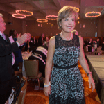 Missouri Supreme Court Chief Justice Mary Russell walks to the stage to receive her award as Women of the Year Thursday night at the Four Seasons Hotel in St. Louis. The 16th annual Women's Justice Awards drew a record attendance.   PHOTOS BY: KAREN ELSHOUT