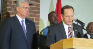 Gov. Jay Nixon listens as St. Louis Mayor Francis Slay speaks at a news conference Thursday in St. Louis. Photo by Catherine Martin