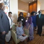 2015 WJA Public Official honoree Anne-Marie Clarke, center, with her family at the reception for the 2015 Women's Justice Awards at the Four Seasons Hotel in St. Louis. Clarke's mother Mary Clarke, seated, is 101.  From left, husband Richard Gaines, sister Denise Levison, and godmother Anita Banks.